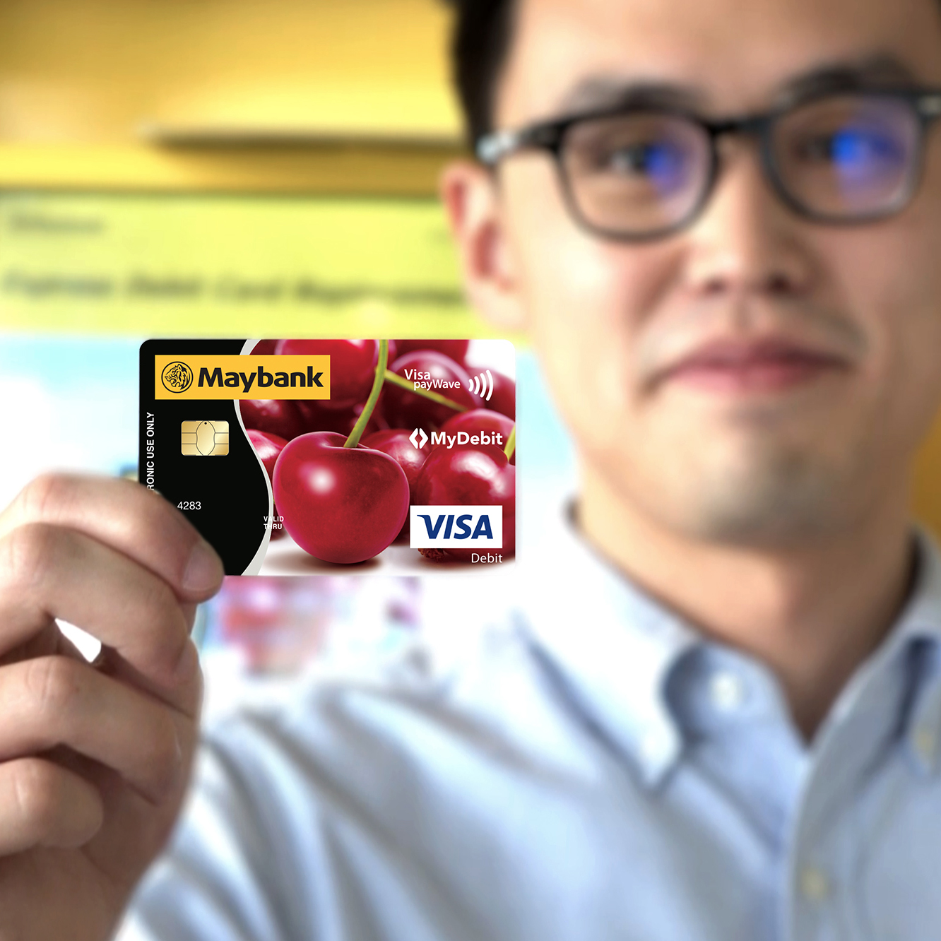 Maybank re-carding video screen with user showing the exchanged debit card
