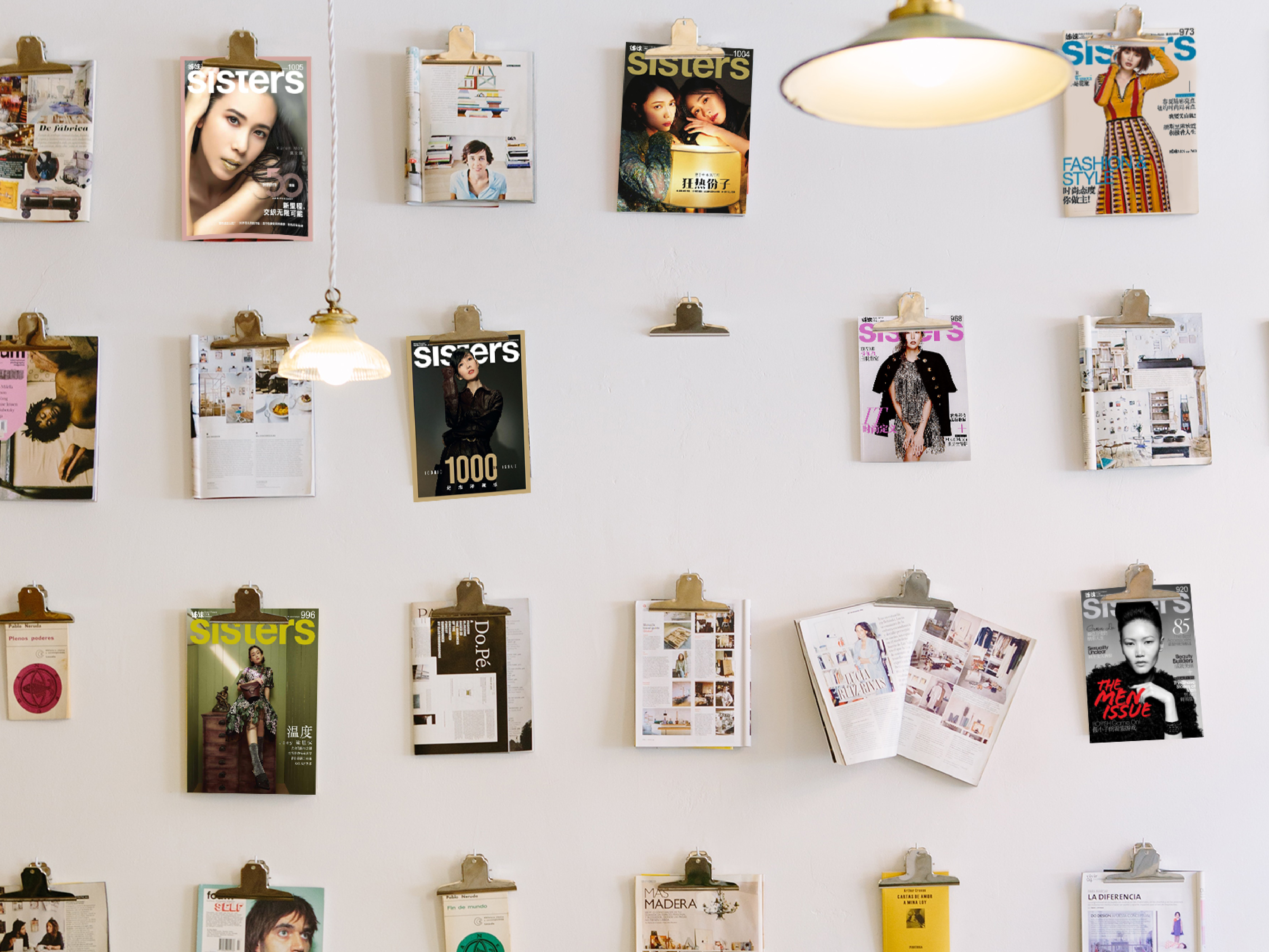 Sisters Magazine issues all hung up against a white wall in commemoration of their 1000th issue