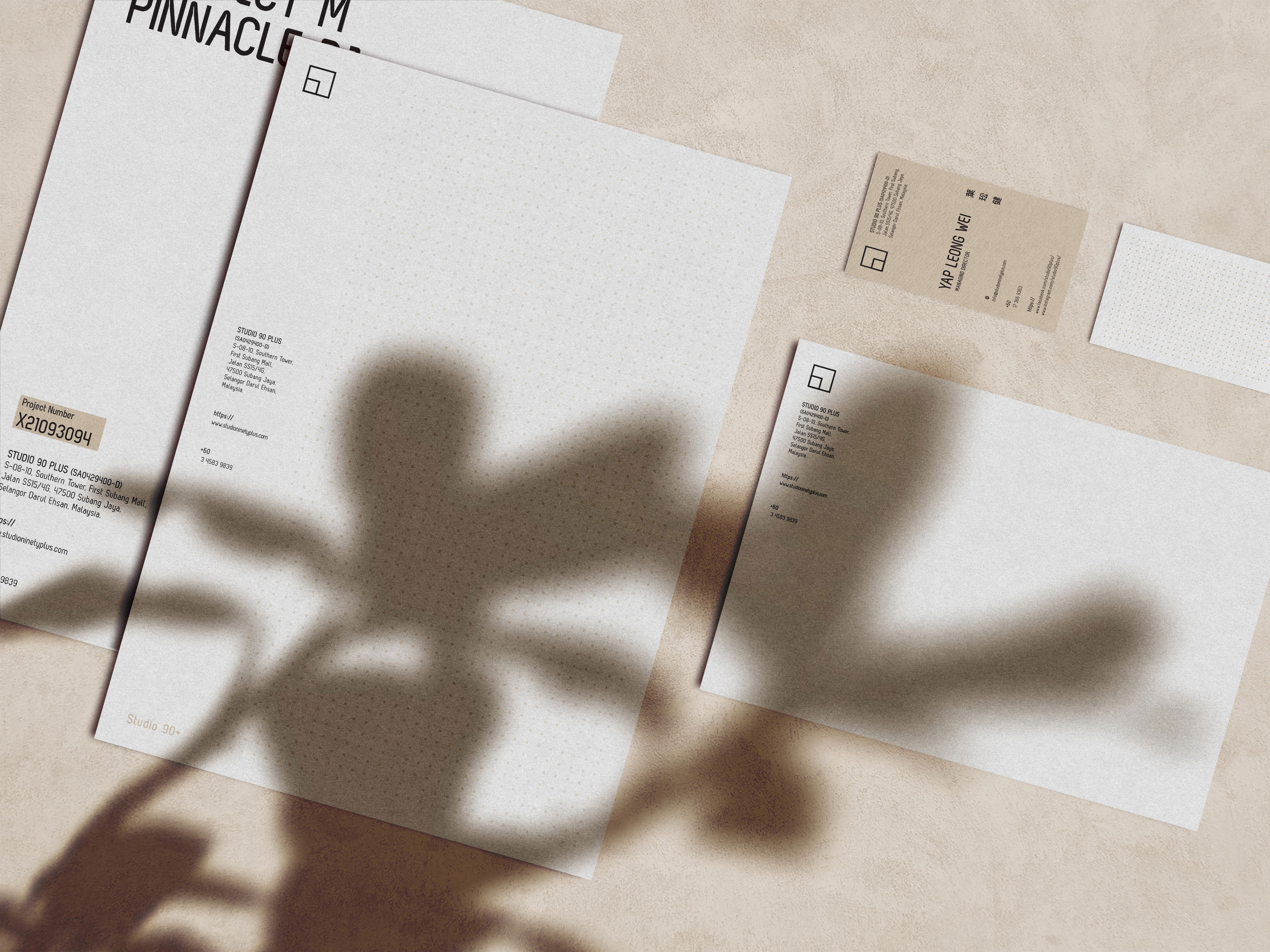 Studio 90Plus brand collaterals showing company project folder, envelope and name card design