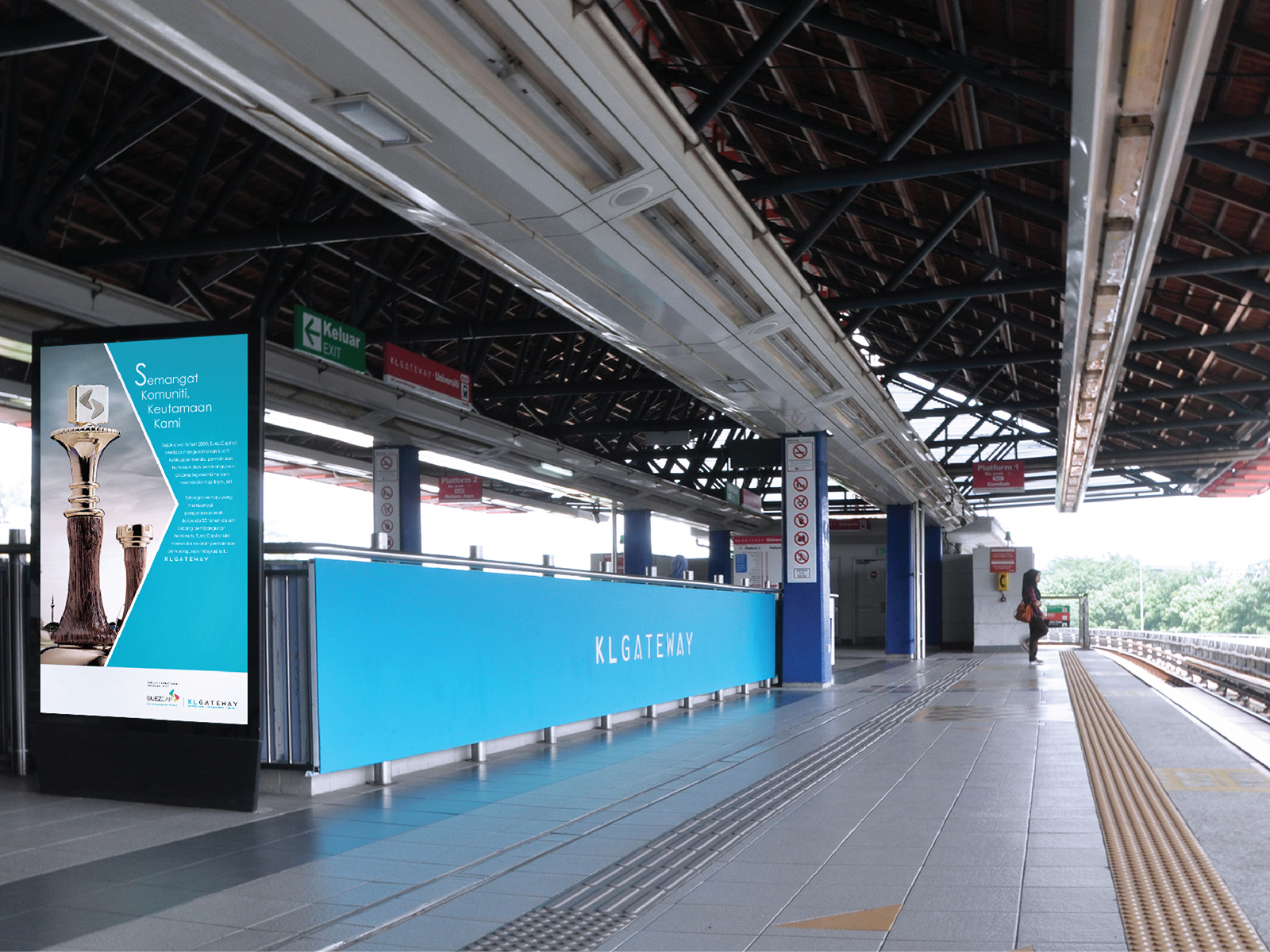 KL Gateway by Suezcap train station brand advertisement takeover with brand ads on handrail panels by the waiting area with digital board ad support