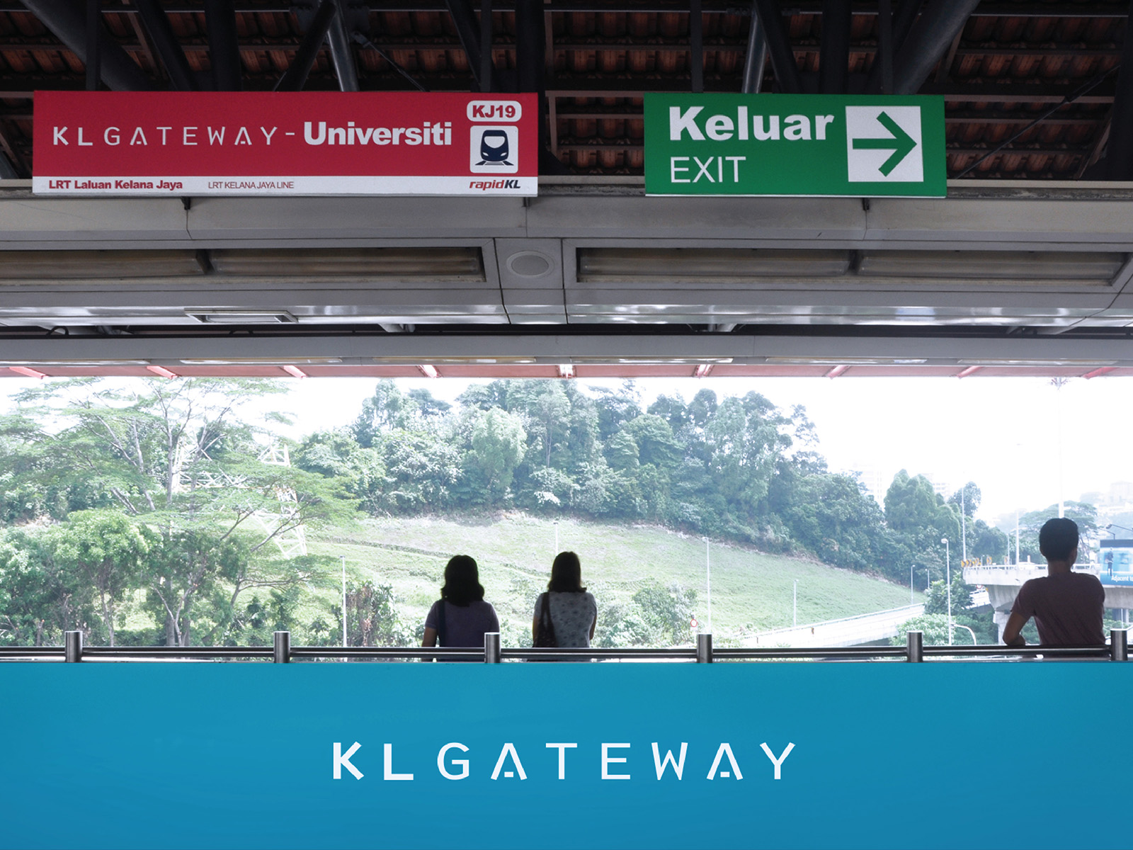 KL Gateway by Suezcap train station brand advertisement takeover on the handrail panels by the waiting area