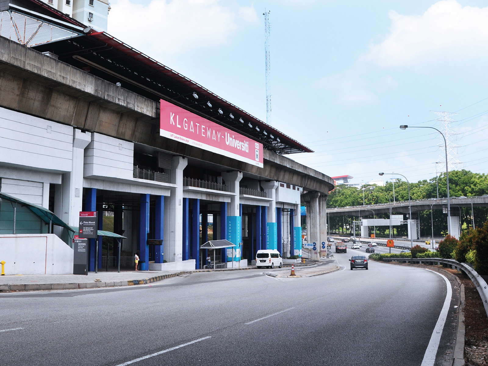 KL Gateway by Suezcap train station brand advertisement takeover and name change to KL Gateway - Universiti signage and pillar wrapped with brand ad
