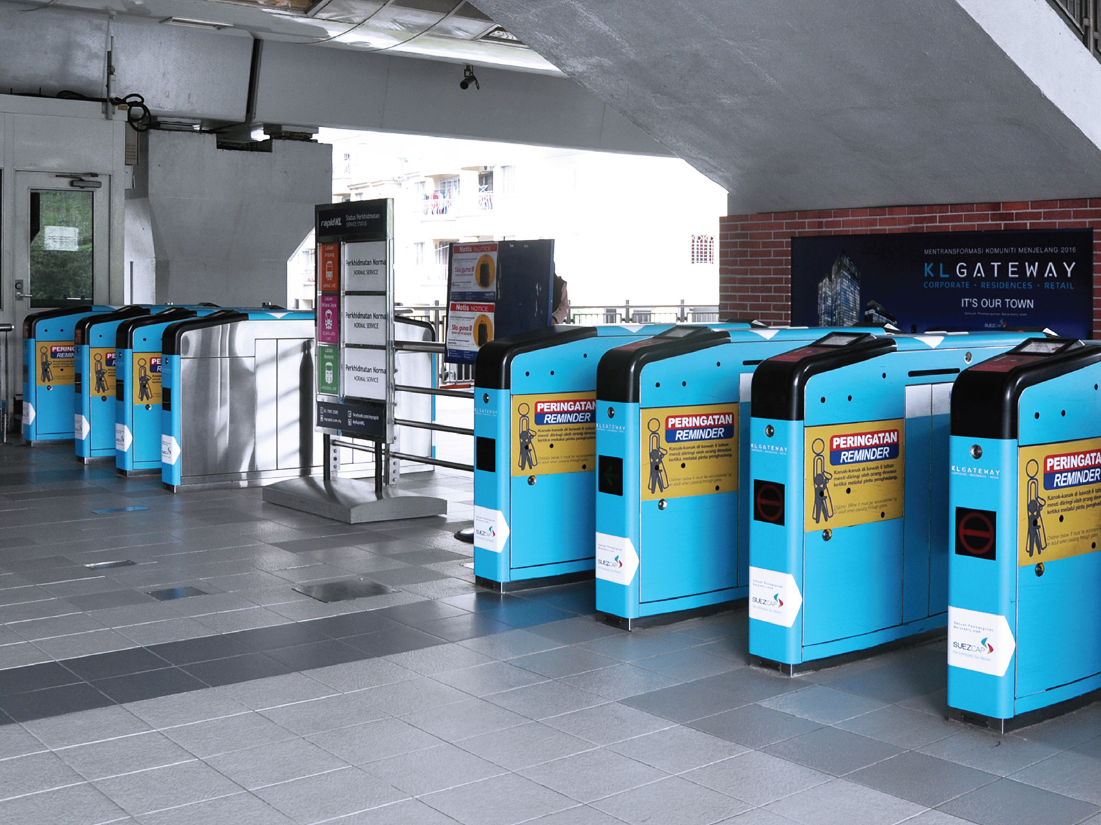 KL Gateway by Suezcap train station brand advertisement takeover sees the ticketing machine wrapped in brand ad