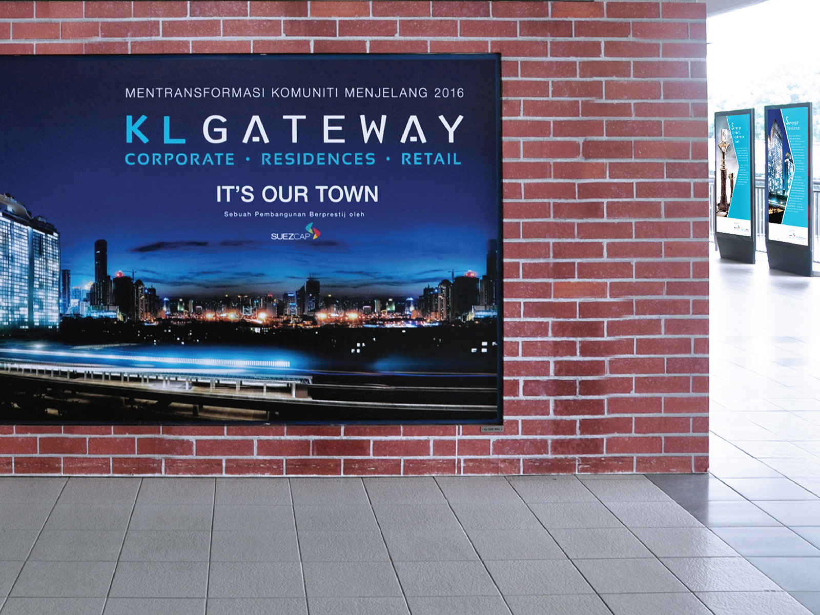 KL Gateway brand advertisement design in the train station display board showing new development facade at night with tagline