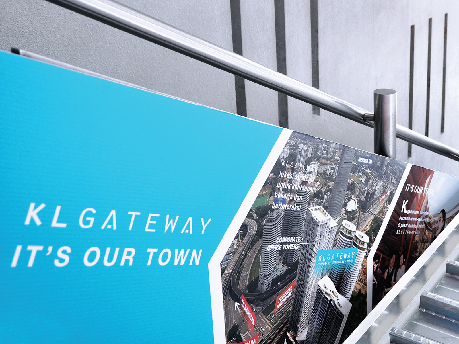 KL Gateway by Suezcap train station brand advertisement takeover with brand ads on handrail panels showing the transformation that is coming to the nearby vicinity