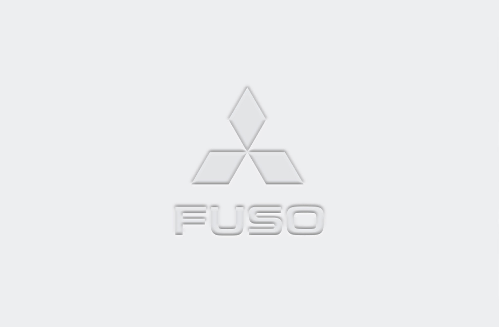 Fuso Trucks logo with pillow emboss effect on white paper background
